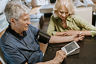 Senior couple taking blood pressure - ZEDF00762