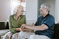 Happy senior couple at home - ZEDF00771