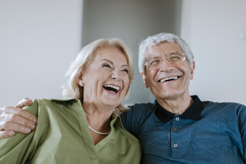 Happy senior couple at home - ZEDF00774
