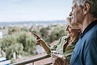 Senior couple talking on balcony - ZEDF00789