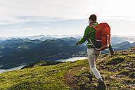 Austria, Salzkammergut, Hiker with backpack hiking in the Alps - UUF10984