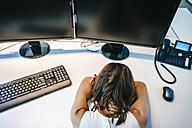 Exhausted businesswoman sleeping on desk - KNSF01994