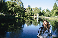 Businesswoman relaxing in the park - KNSF02024
