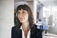 Portrait of a pensive businesswoman - KNSF02030