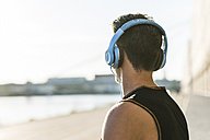 Young man with headphones looking at distance - UUF11152