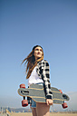 Portrait of young woman with longboard - DAPF00781