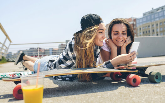 Two young women with longboards enjoying summer - DAPF00799