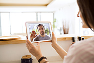 Young woman using tablet for video chat at home - HAPF01886