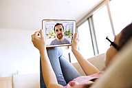 Young woman using tablet for video chat at home - HAPF01892