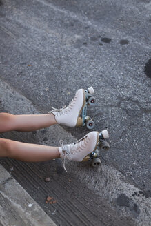 Young woman with roller skates on lane, partial view - JPF00251