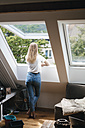 Young woman looking out of window - GUSF00131