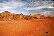 Jordan, Wadi Rum, man walking through desert - DSGF01687