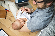 Father with his baby daughter working from home - HAPF01983