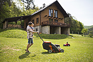 Father with his little son mowing the lawn - HAPF01992