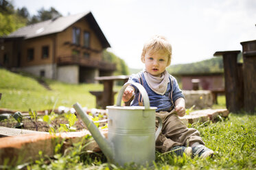 Boy in garden with watering can - HAPF02016