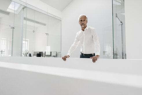 Mature businessman in bright office - KNSF02132