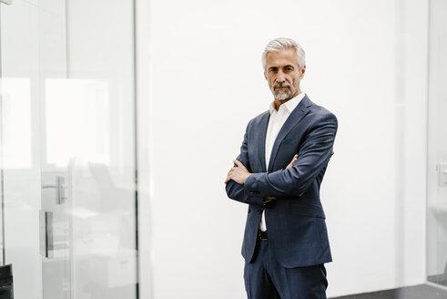 Portrait of serious mature businessman in office - KNSF02198