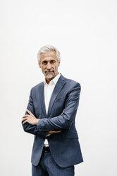 Portrait of confident mature businessman - KNSF02201
