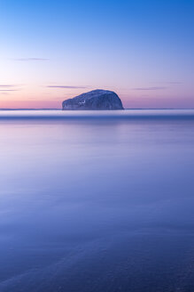 UK, Scotland, North Berwick, Firth of Forth, view to Bass Rock with lighthouse at sunset, long exposure - SMAF00779