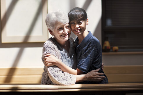 Nurse embracing senior woman in retirement home - ZEF14217