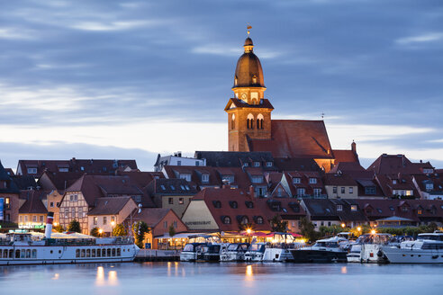 Germany, Waren, view to Mueritz, harbour and city at blue hour - WIF03418