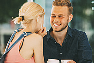 Portrait of happy young man drinking coffee with his girlfriend - CHAF01932