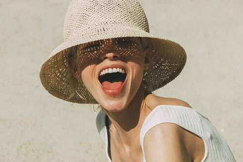 Portrait of laughing blond woman wearing summer hat - CHAF01941