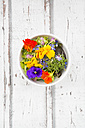 Bowl of leaf salad with various edible flowers - LVF06242
