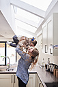 Mother and little daughter having fun together in the kitchen - IGGF00006