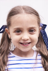 Portrait of smiling little girl with braids - IGGF00024