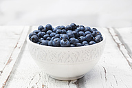 Bowl of blueberries on wood - LVF06245