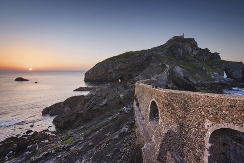 Spain, Basque Country, San Juan de Gaztelugatxe hermitage at sunset - DHCF00123