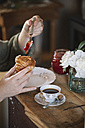 Close-up of woman tasting homemade croissants with jam - ALBF00148