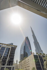 United Arab Emirates, Dubai, Buildings at Emaar Square with Burj Khalifa in the background - NKF00477