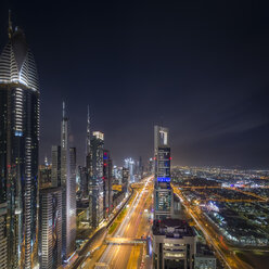 United Arab Emirates, Dubai, aerial overview of sheikh zayed road with high rises of Financial centre district and Burj Khalifa in the background - NKF00480