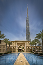United Arab Emirates, Dubai, Burj Khalifa with traditional arabic styled houses and water basin - NKF00483