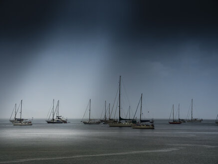 Caribbean, Dominica, moored sailing boats in stormy weather - AMF05408