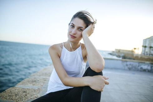 Portrait of young woman on boardwalk - KIJF01678