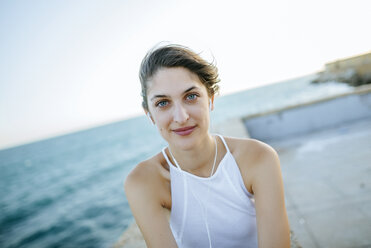 Portrait of young woman at the coast - KIJF01681