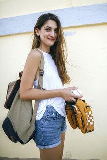 Portrait of young woman with baseball and baseball glove - KIJF01696