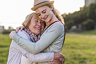 Happy grandmother and granddaughter hugging each other - UUF11382