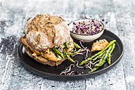 Salmon burger with green asparagus and red cress on plate - SARF03347