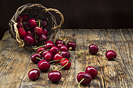 Wickerbasket of cherries on wood - LVF06258