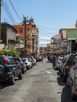 Caribbean, Antilles, Dominica, Roseau, People walking in the street - AMF05412