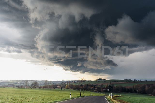 Stormy atmosphere over empty country road - MJF02143