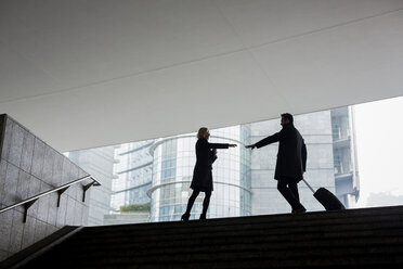 Businessman and businesswoman meeting in the city - MAUF01193