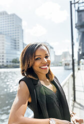 Portrait of a smiling beautiful woman in the city - MGOF03475