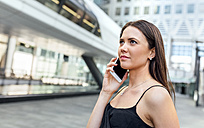 Young woman on the phone in the city - MGOF03496