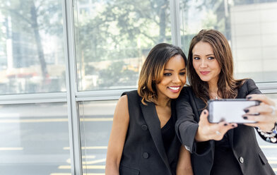 Two women taking a selfie in the city - MGOF03520