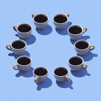 Coffee cups building circle on light blue ground, 3D Rendering - DRBF00009